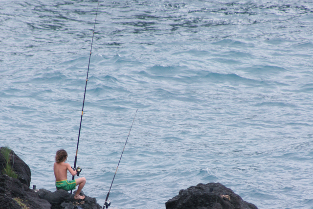 young boy fishing in hana