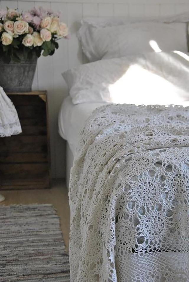 Crochet vintage linens repurposed as a bedspread