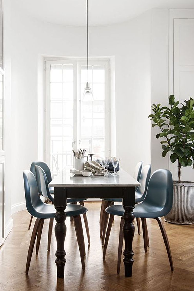 Dining room interior design ideas. Eclectic mix of old and new makes this modern dining room shine. I love the marble top on this dining room table!