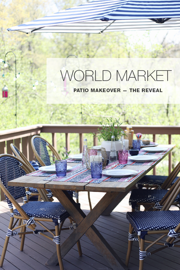 Boho Patio Makeover with World Market. Tribal inspired pink and navy table runner. Saturated navy and pops of pink with hits of brass tea lights and hanging moroccan lanterns.