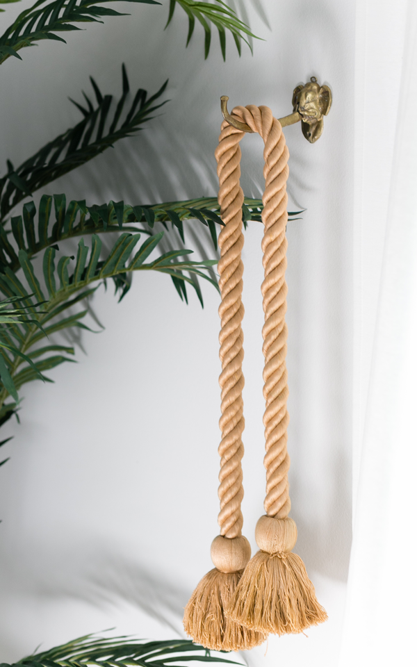 Decorist DesignOff with Jojotastic. Interior styling details. Brass elephant hook with tassels from Paris.
