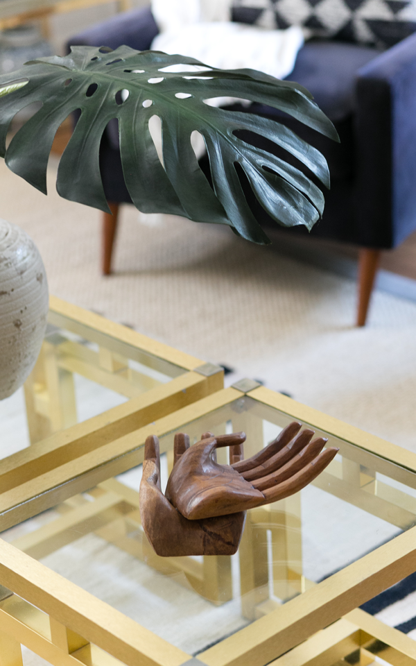 Decorist DesignOff with Jojotastic. Interior styling details. I love these vintage wooden carved hands resting on the glass and brass side tables.