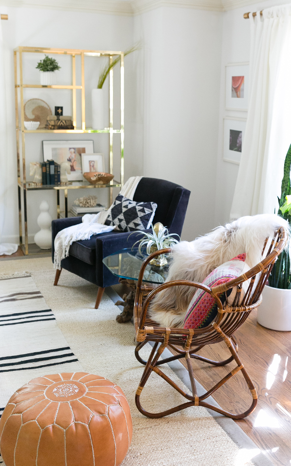 Decorist DesignOff Living Room Makeover Final Reveal with Franko Albini rattan club chair, and Milo Baughman vintage brass etagere from The South Loop Loft in Chicago, IL. Modern boho living room interior design and styling