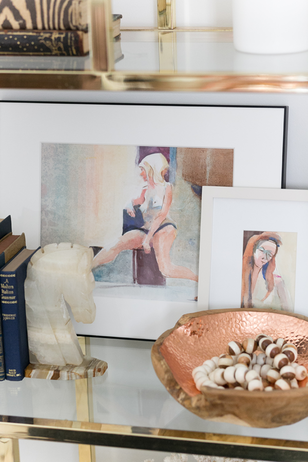 Decorist DesignOff with Jojotastic. Milo Baughman brass etagere from South Loop Loft Chicago close up. Rich Buchwald watercolor paintings and marble horse head from The Savoy Flea.