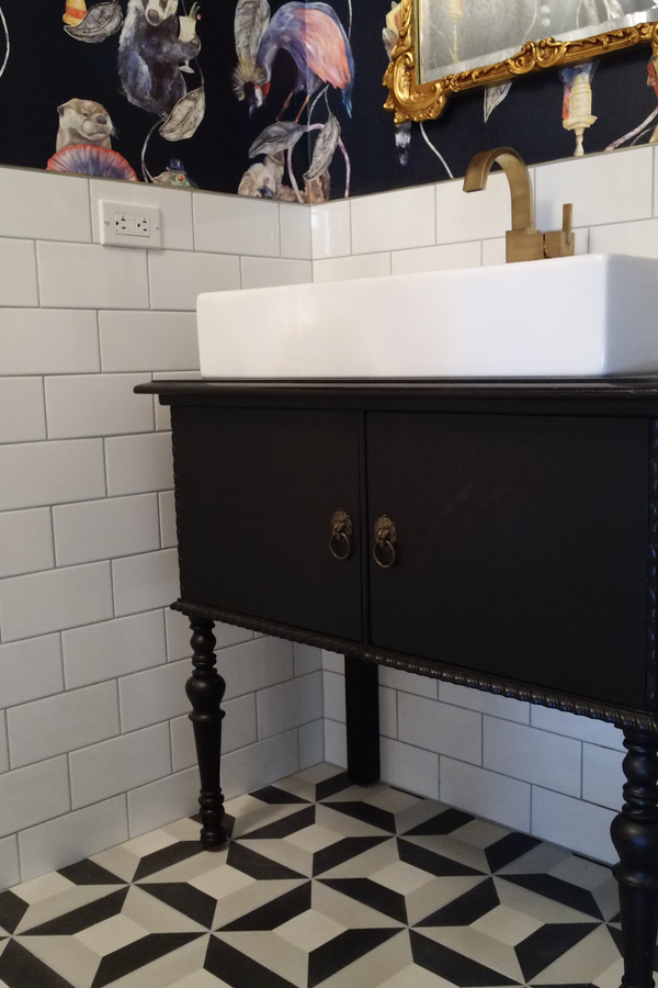 House Of Hackney Empire midnight wallpaper and white subway tile from Clé Tile on the walls and cement tiles - Cubicon - on the floor by Clé Tile