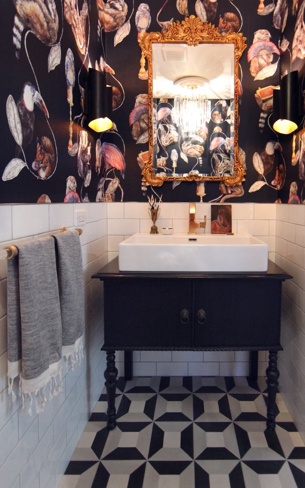 An antique dresser was converted into a bathroom vanity. I love the eclectic wallpaper by House Of Hackney - Empire Midnight. I love the Clé Tile Cubicon cement tiles on the floor paired with white subway tile.