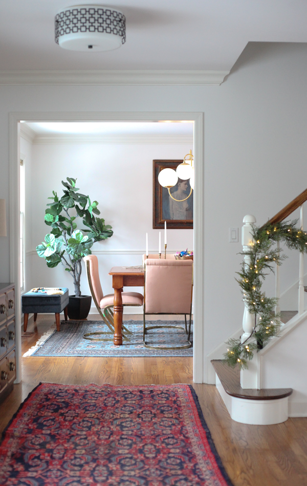 House Of Hipsters Holiday Home Tour - BSHT Christmas 2016 — The banister has traditional garland, yet the foyer still looks eclectic with the Dorothy Draper dresser and Persian rug.
