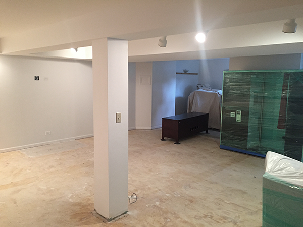 We painted the basement in Sherwin Williams Snowbound. A bright white paint without a yellow tint.