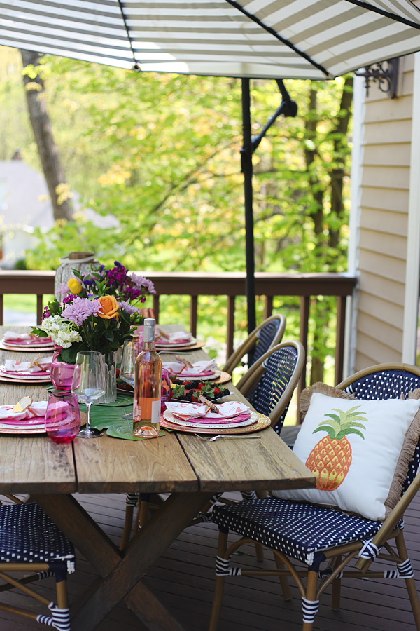 Outdoor Entertaining in the Neighborhood - Loving the pop of pink and green with the pineapple pillow. #Pier1BlockParty #pier1love