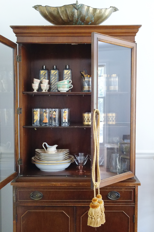 Victorian china cabinet with mid-century modern barware inside