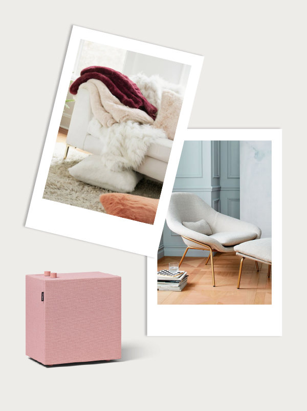 Cozy fur blanket, comfy womb chair. and a pink wireless speaker