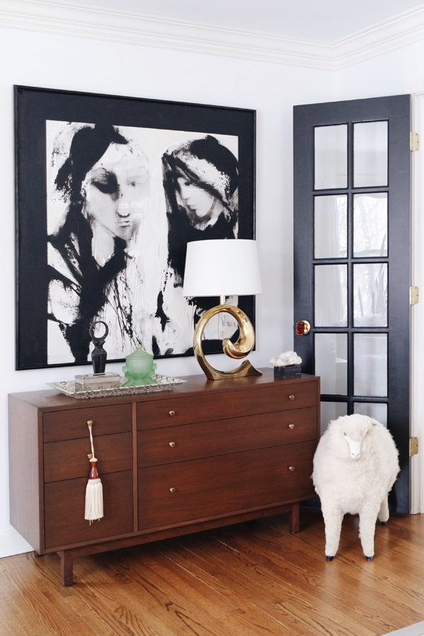 No Makeup Home Tour - House of Hipsters Living Room wood mid century modern dresser repurposed in living room and french lelane sheep footstool