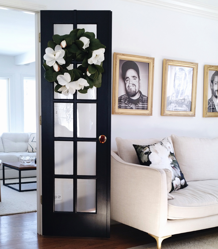 Painted black French doors in modern living room
