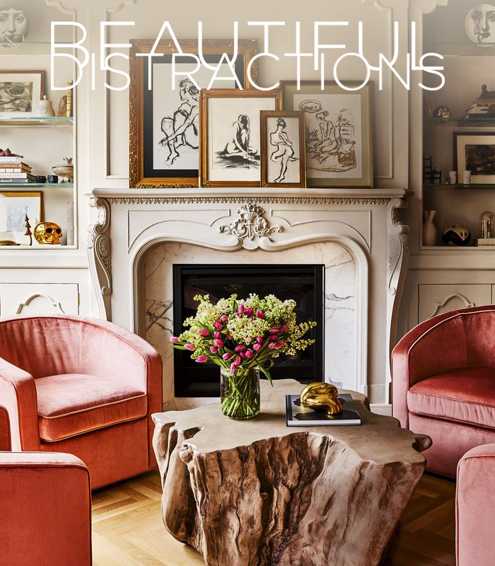 Alison Victoria's Chicago home in House Beautiful - Love the pink velvet club chairs and antique marble fireplace with the charcoal nudes.